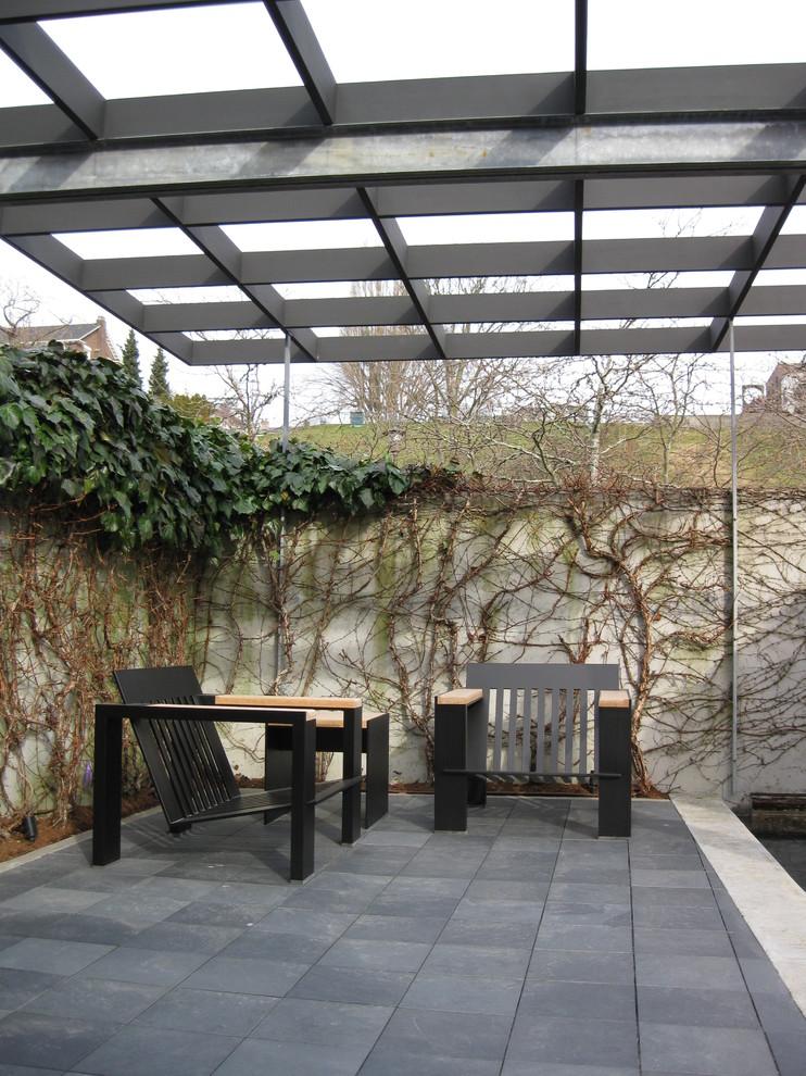 Minimalist patio photo in Seattle with a pergola