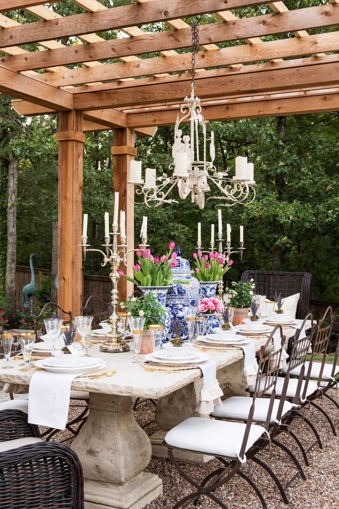 Elegant backyard patio photo in Little Rock with a pergola