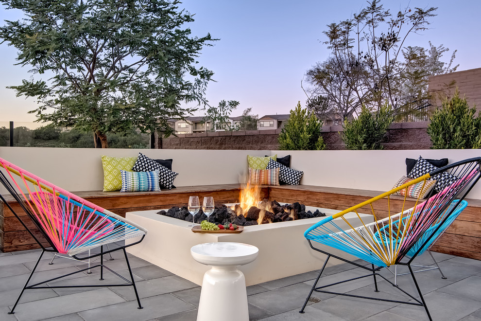 Patio - contemporary patio idea in Orange County with a fire pit and no cover