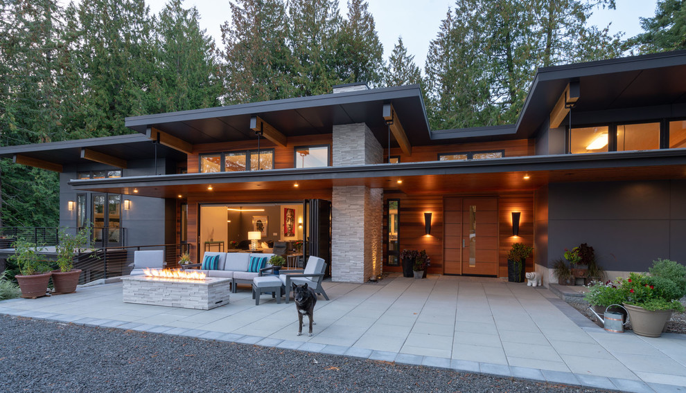 Trendy front yard patio photo in Seattle with a roof extension