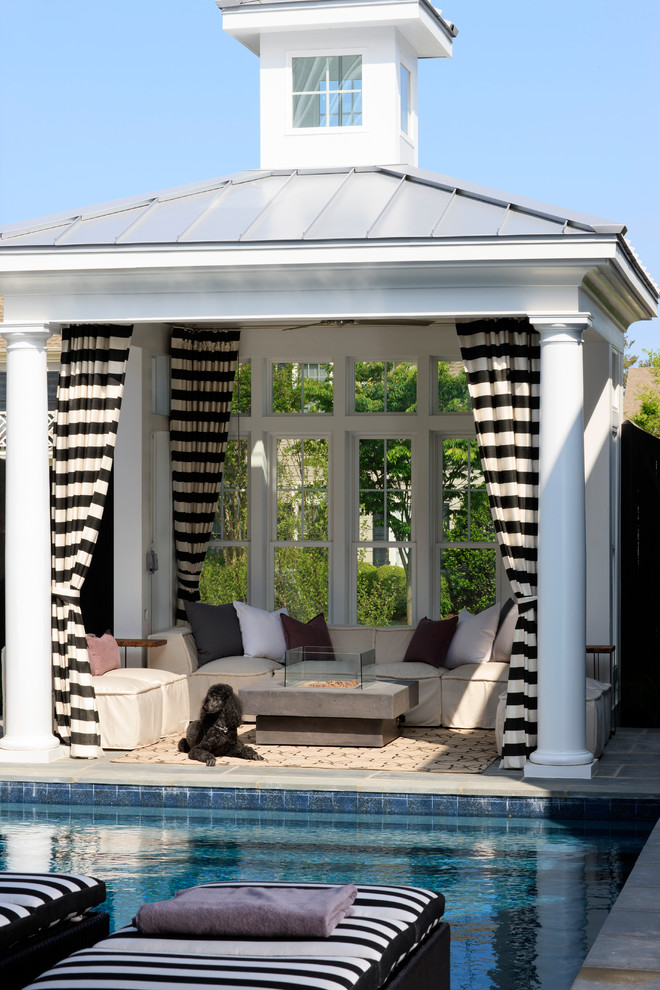 Beach style backyard tile patio photo in DC Metro with a gazebo and a fire pit