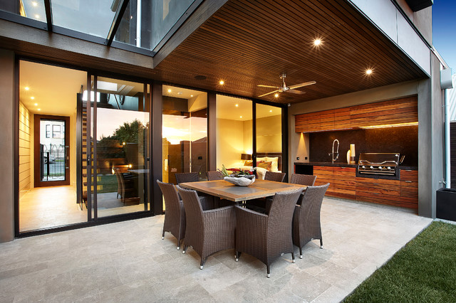 Photo of a contemporary patio in Melbourne with natural stone pavers.