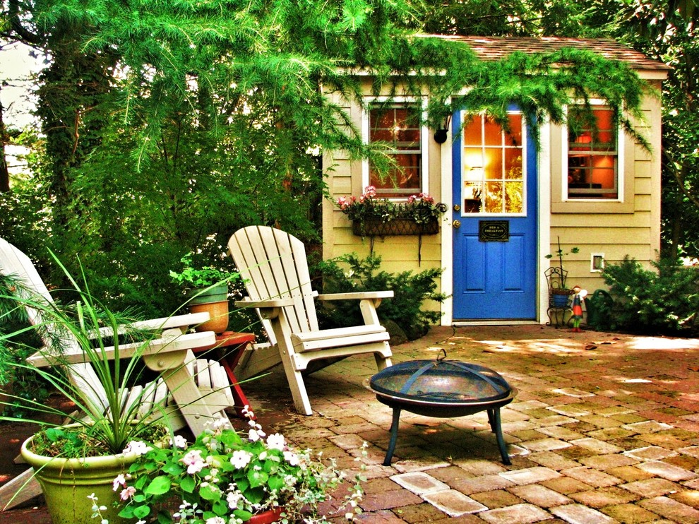 Patio - traditional brick patio idea in Other