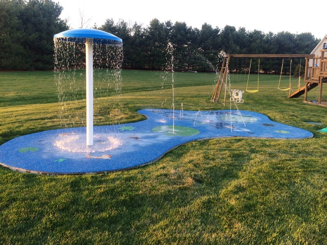 Residential splash pad for your backyard for Garden pool for dogs