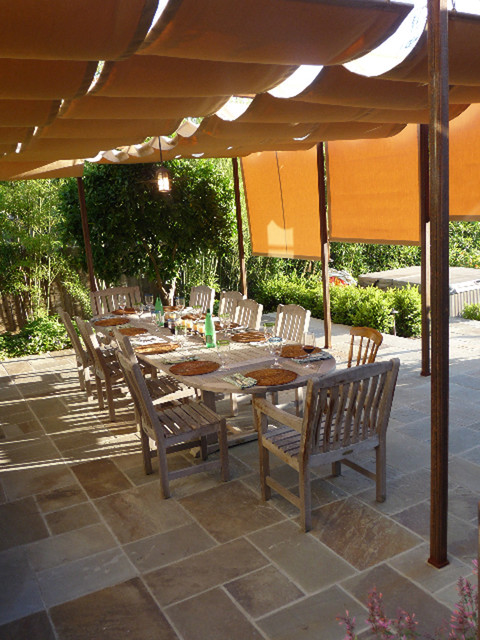 retractable sun shades at covered terrace traditional
