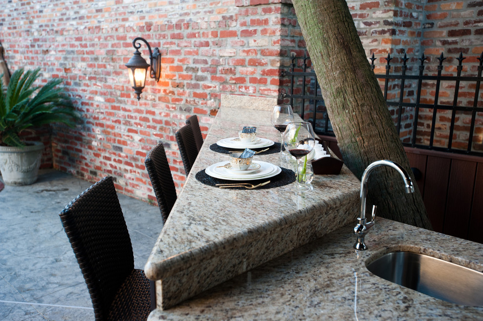 Example of a trendy patio design in New Orleans