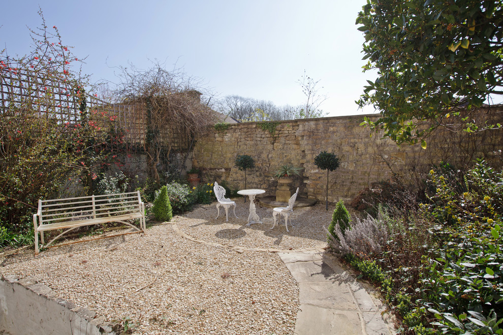 Elegant gravel patio photo in London with no cover