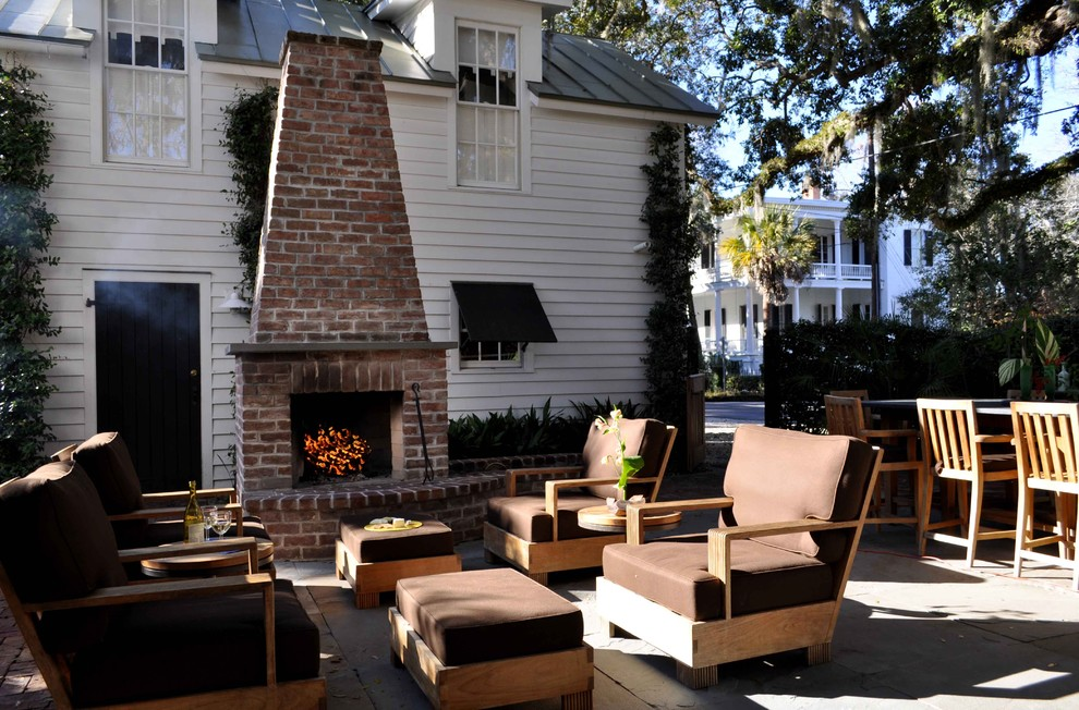 Mid-sized elegant backyard stone patio photo in Atlanta with a fire pit and no cover