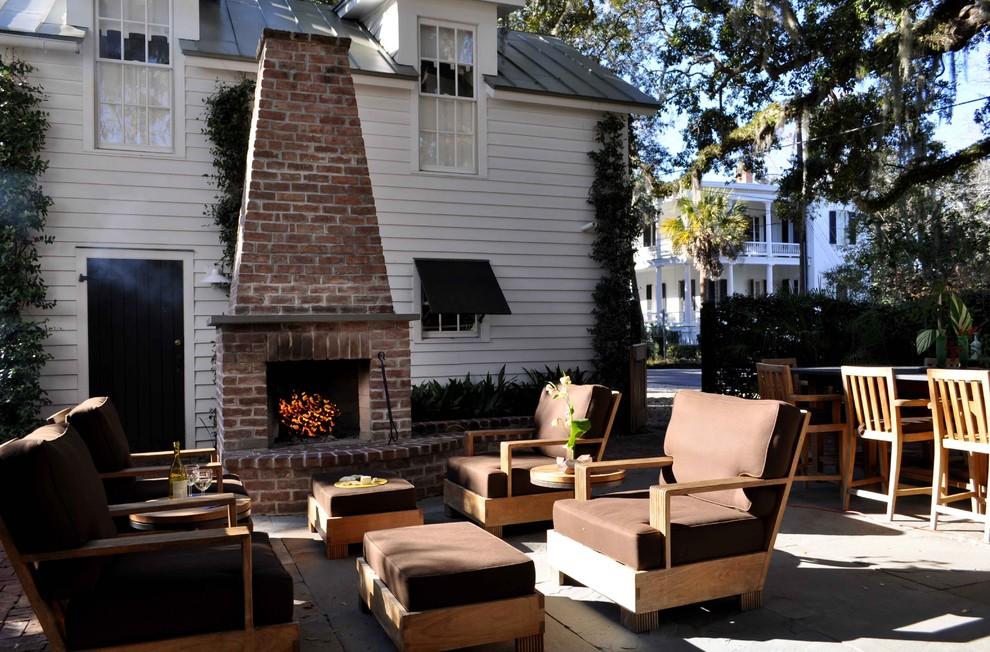 Mid-sized elegant backyard stone patio photo in Atlanta with a fire pit