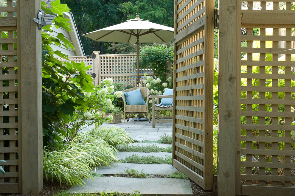 Example of a classic patio design in New York with no cover
