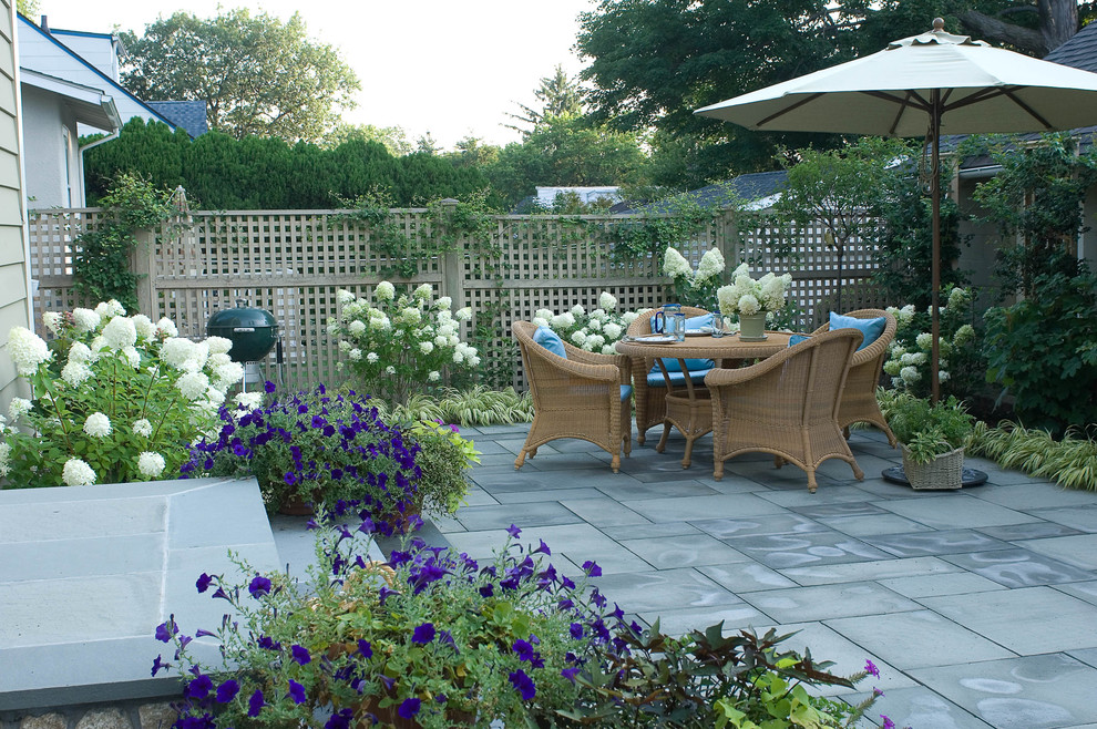 Elegant patio photo in New York with no cover