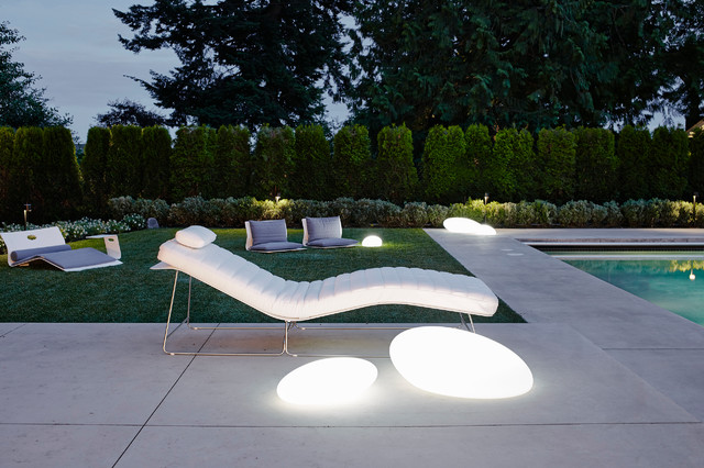 Inspiration for a large contemporary stamped concrete patio remodel in Vancouver