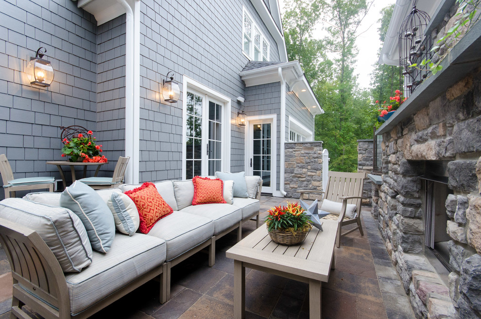 Mid-sized elegant backyard stone patio photo in Richmond with no cover and a fireplace
