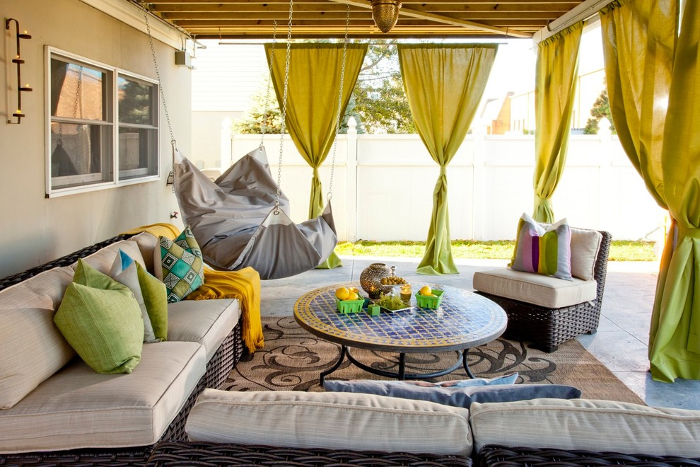 Inspiration for an eclectic backyard patio remodel in New York with a fire pit