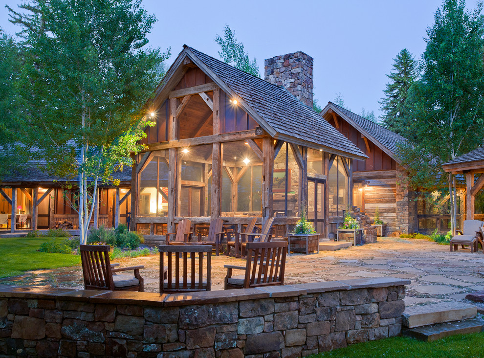 Mountain style stone patio photo in Other with no cover