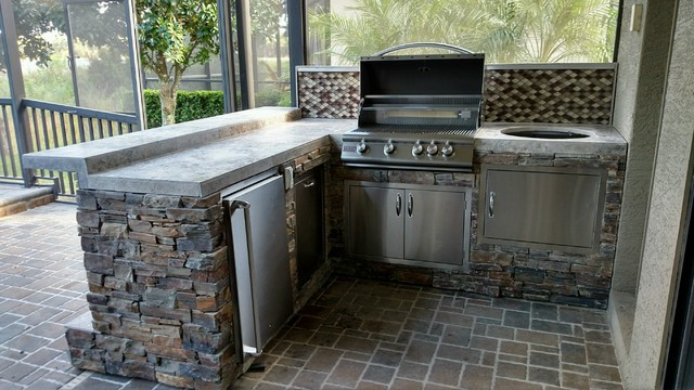 Rustic stacked stone L shaped kitchen with Green Egg - Rustic ...