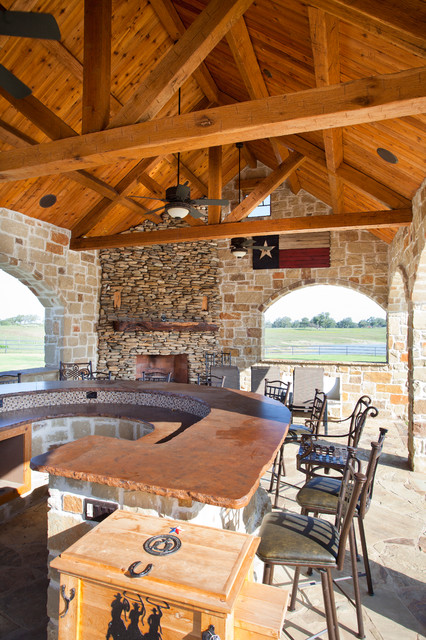 Rustic timber frame home on tx ranch traditional patio for Rustic timber frame homes