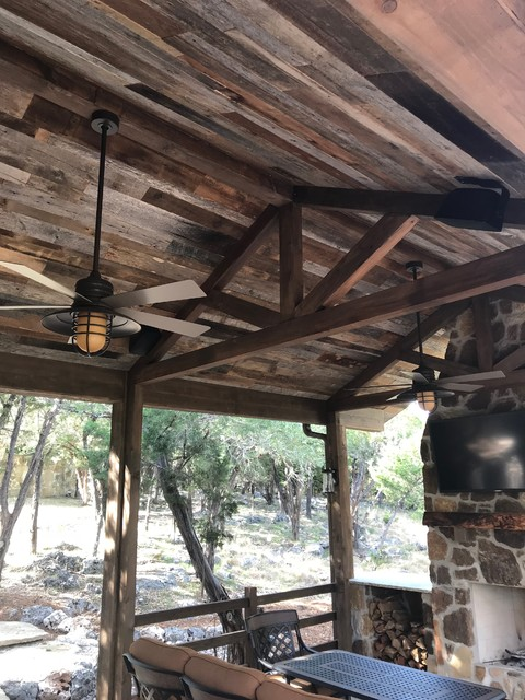 Inspiration for a mid-sized rustic backyard patio remodel in Other with a gazebo