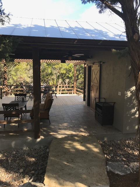 Mid-sized mountain style backyard patio photo in Other with a gazebo