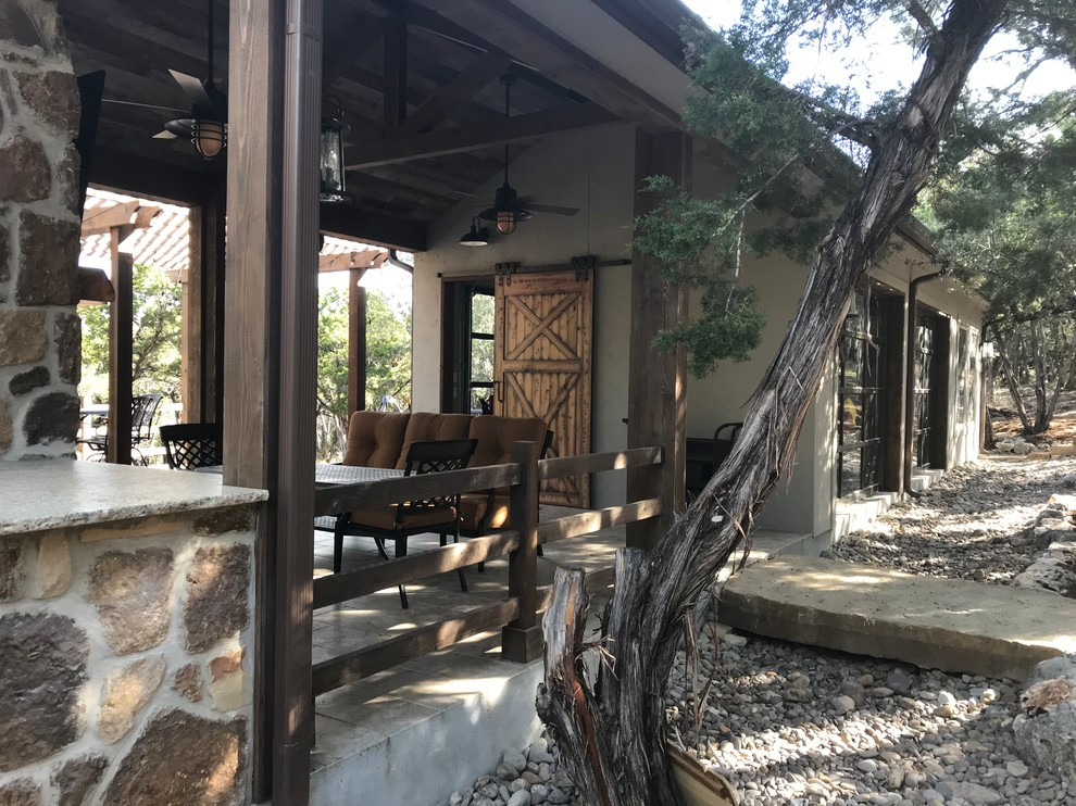 Patio - mid-sized rustic backyard patio idea in Other with a gazebo