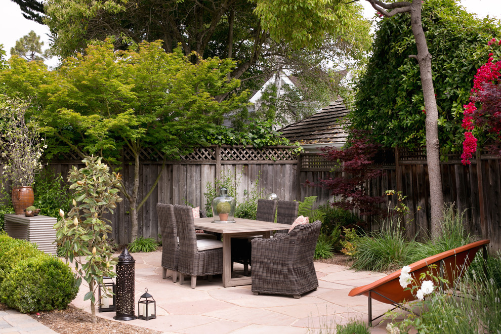 Patio - mid-sized traditional backyard stone patio idea in San Francisco with no cover