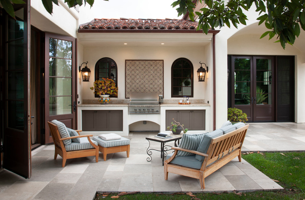 Patio kitchen - mediterranean patio kitchen idea in San Diego with no cover