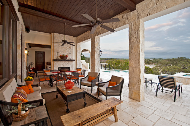 Large Tuscan Backyard Tile Patio Photo In Austin With A Fire Pit And A Roof  Extension