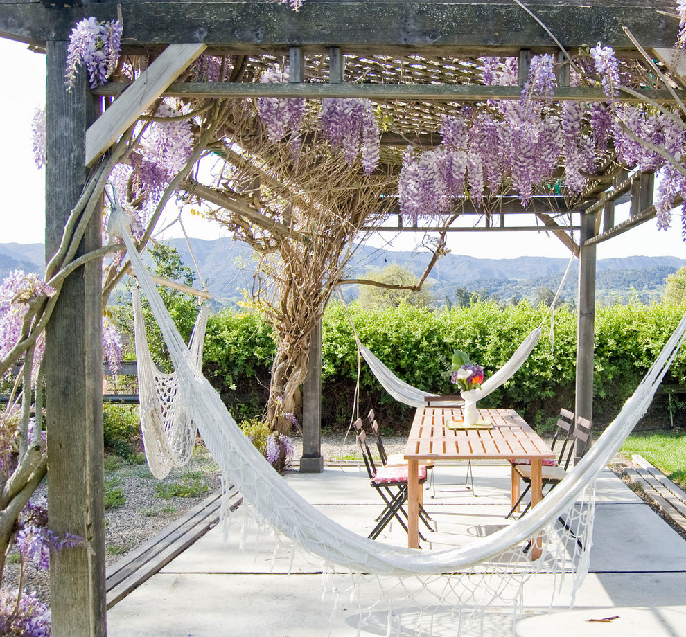 Inspiration for a farmhouse backyard patio remodel in Santa Barbara with a pergola