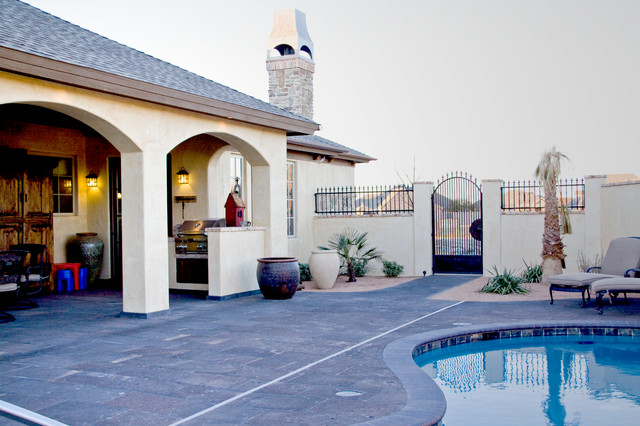Example of a tuscan side yard tile patio design in Austin