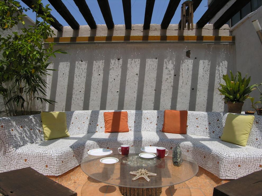 Patio - coastal patio idea in Pune with a pergola