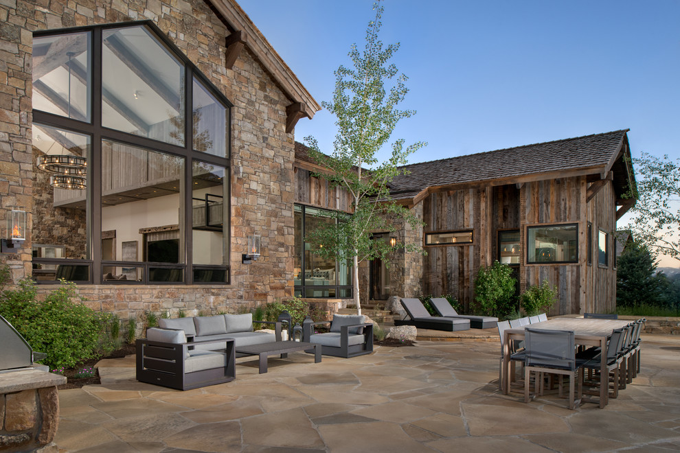Example of a mountain style patio design in Other with no cover