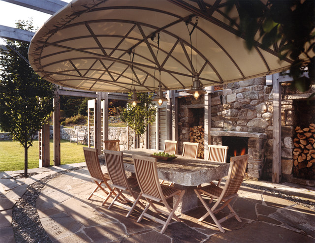 trendy patio photo in portland with a fire pit - Stone Slab Canopy Decorating