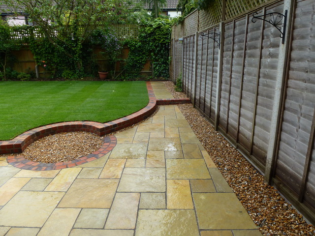 Simple back garden after patio south east by for Back garden patio designs