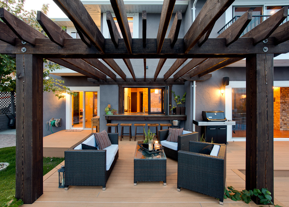Inspiration for a timeless patio remodel in Vancouver with decking and a pergola