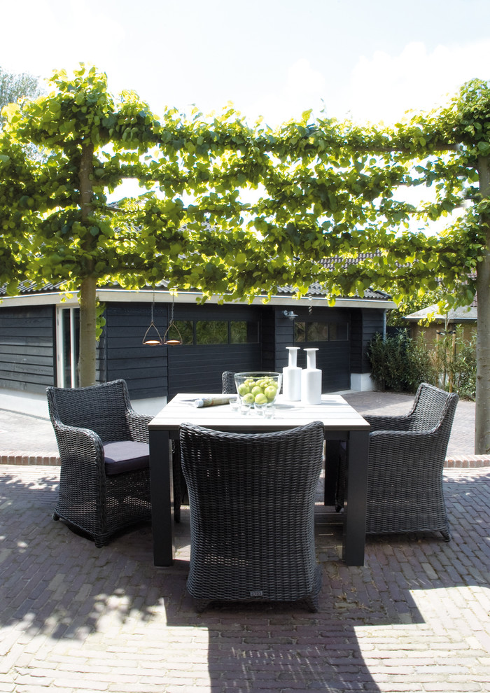 Inspiration for a contemporary patio remodel in Amsterdam with no cover