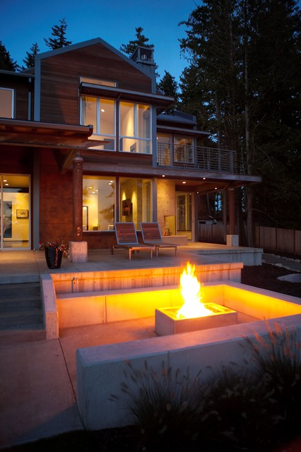 Fire pit at dusk. modern patio