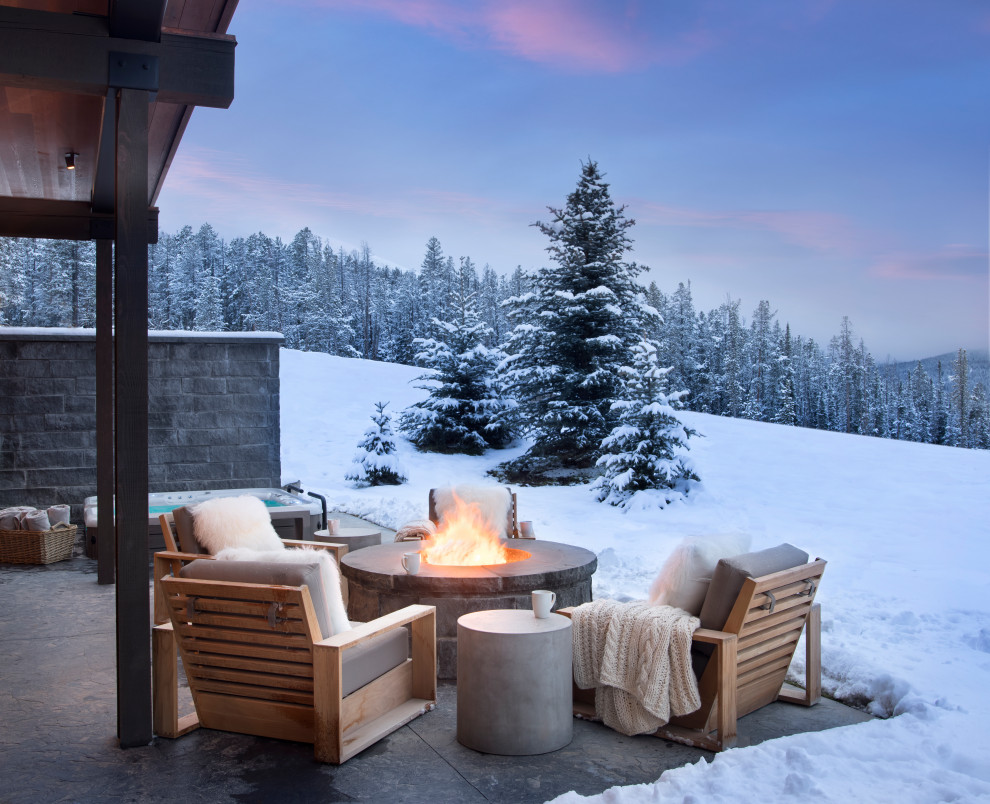 Inspiration for a rustic patio remodel in Other with a fire pit and no cover