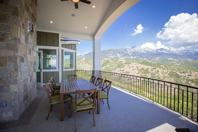 Inspiration for a large backyard patio remodel in Salt Lake City with a roof extension