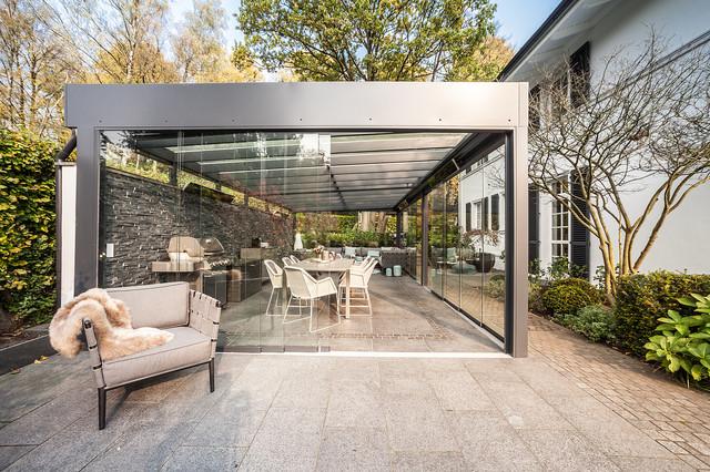 Patio kitchen - large contemporary backyard concrete paver patio kitchen idea in Hamburg with a gazebo