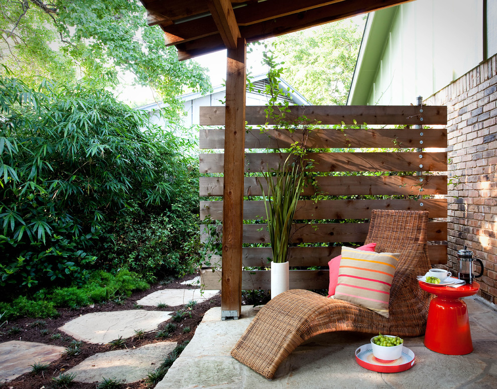 Inspiration for a timeless stone patio remodel in Austin