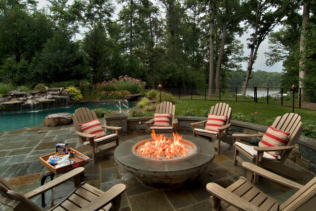 Example Of A Clic Patio Design In Dc Metro With Fire Pit And No Cover