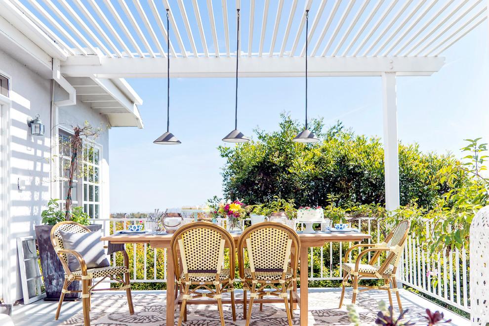 Patio - small eclectic backyard concrete patio idea in Los Angeles with a pergola