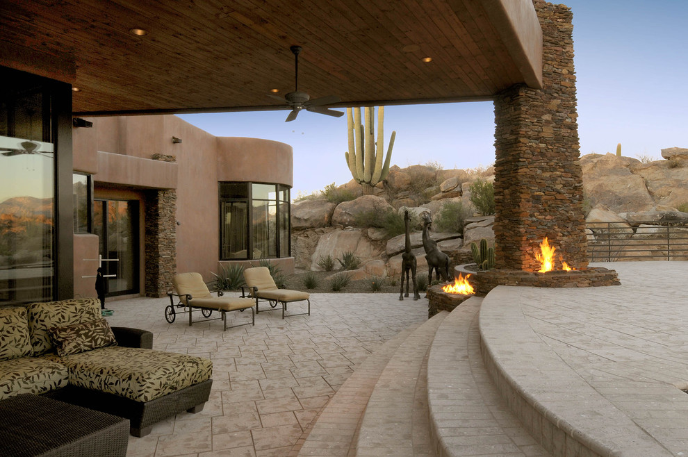 Southwest patio photo in Phoenix with a fire pit