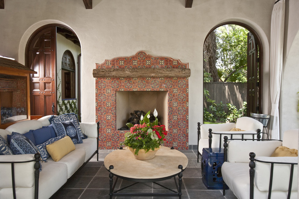 Example of a southwest tile patio design in Houston with a fire pit
