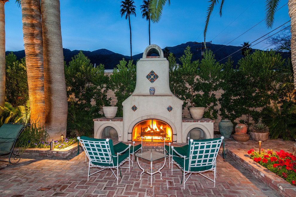 Example of a tuscan patio design in Denver