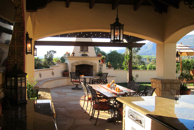 Spanish style covered outdoor dining with fireplace in for Spanish style outdoor fireplace