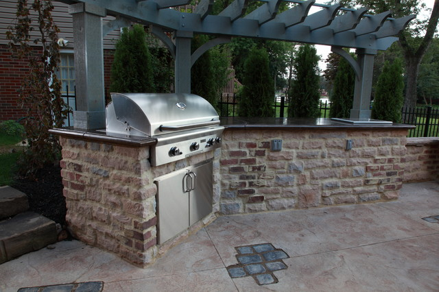 Stamped concrete outdoor kitchen with paver inlays for Outdoor kitchen ideas houzz
