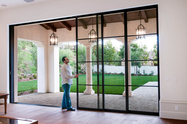 Steel pocket sliding doors mediterranean patio for Backyard sliding door