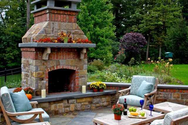 Stone & Brick Fireplace Anchor this Outdoor Livingroom ... on Brick Outdoor Fireplace Ideas id=29052
