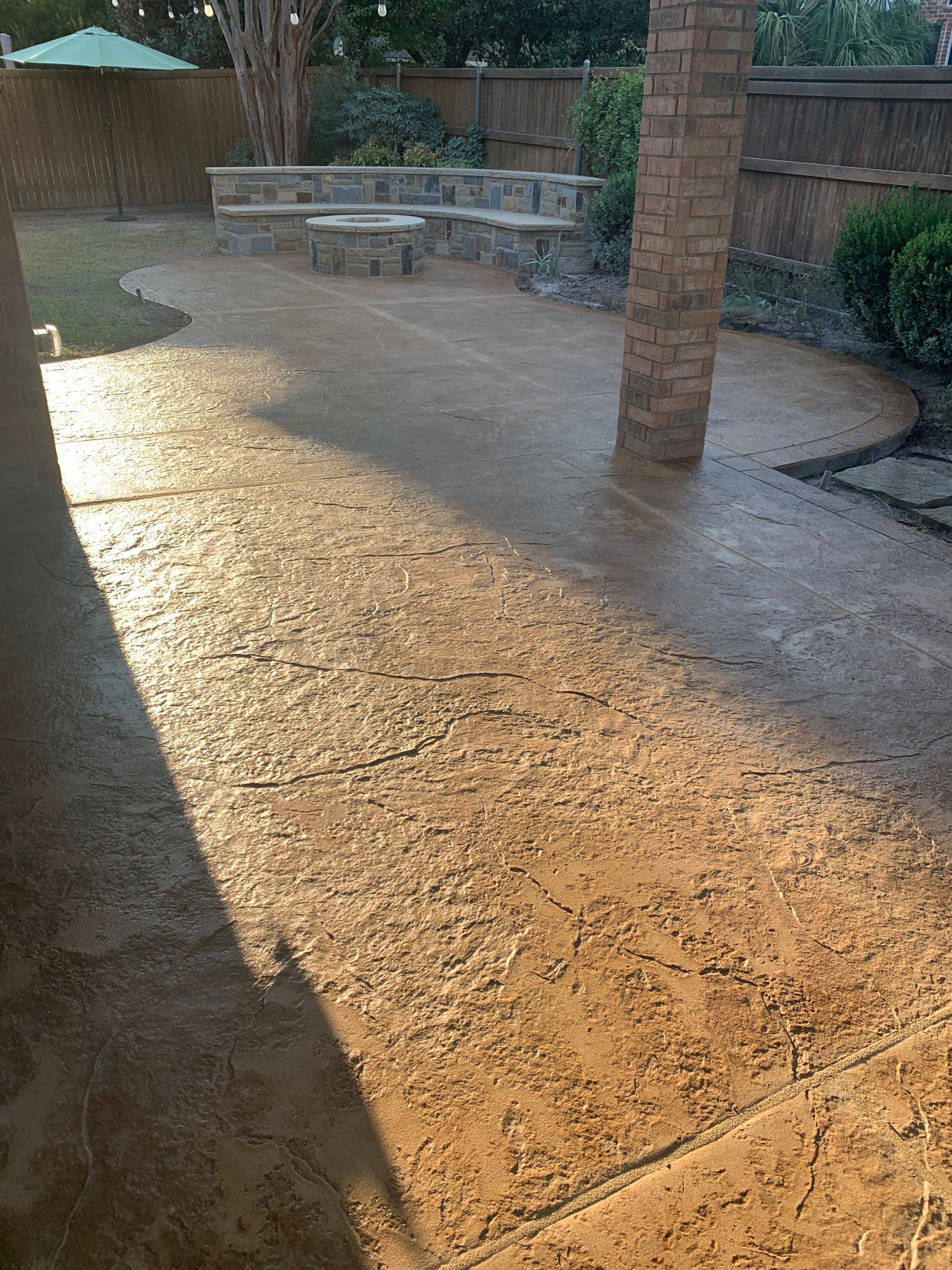 Stone benches, fire pit and stamped concrete